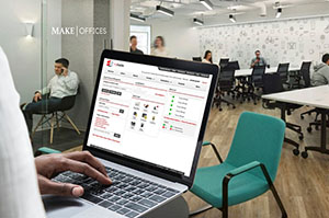 Person with Laptop using myKastle in MakeOffices space